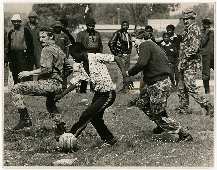 Riot police playing a game of soccer with youths in Nyanga. 27 August 1976 Photo by John Paisley